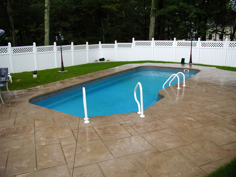 Clearwater pools custom shaped pools inground pool for Pool design louisville ky